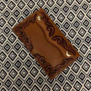 Leather wallet with snap closers.